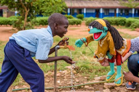 Raya the Muppet helps a boy get clean water through World Vision's WASH UP! model. Photo Credit: World Vision
