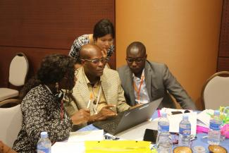 Conference attendees learn how to use the WHO LF diagnostics feedback form